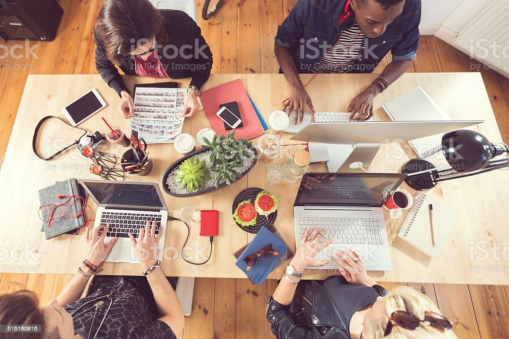 High angle view of creative people working at the table stock photo