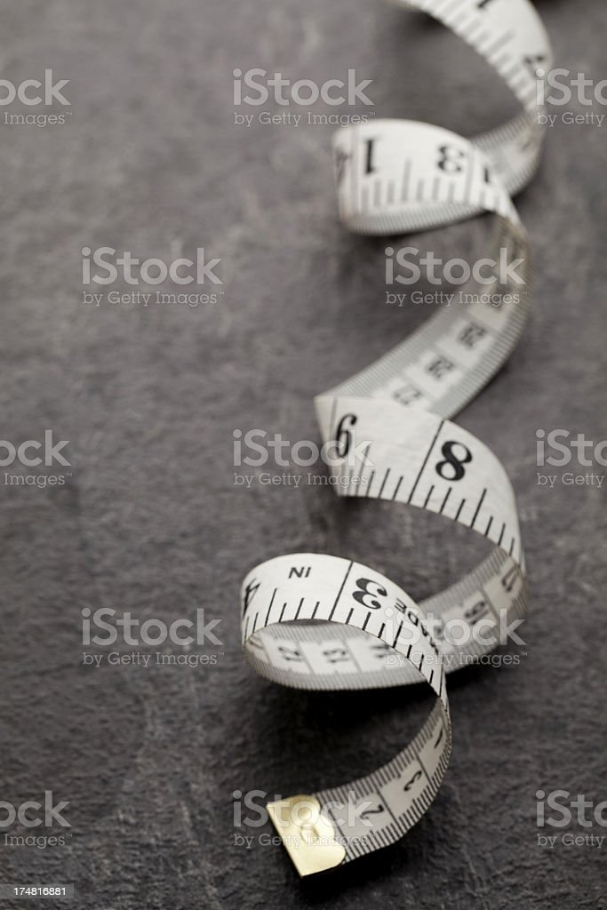 high angle view of curled length of measuring tape royalty-free stock photo