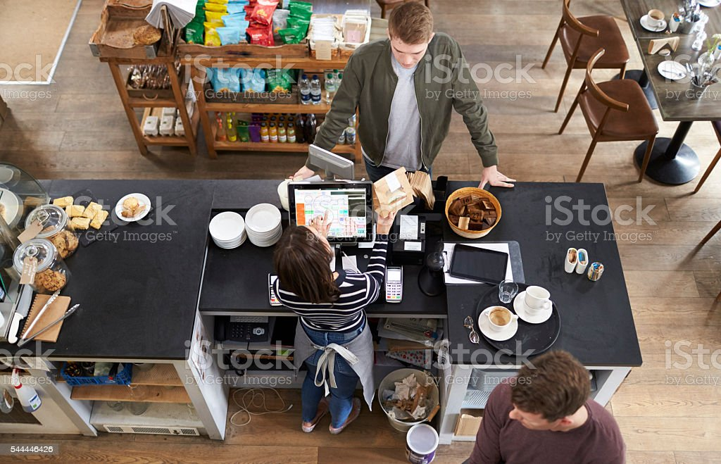 High angle view of customer at the counter of a coffee stock photo
