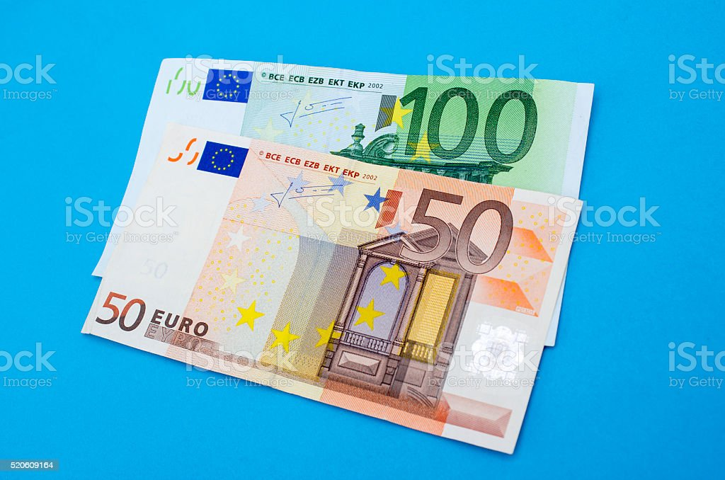 High angle view of fifty and one hundred euro banknotes stock photo