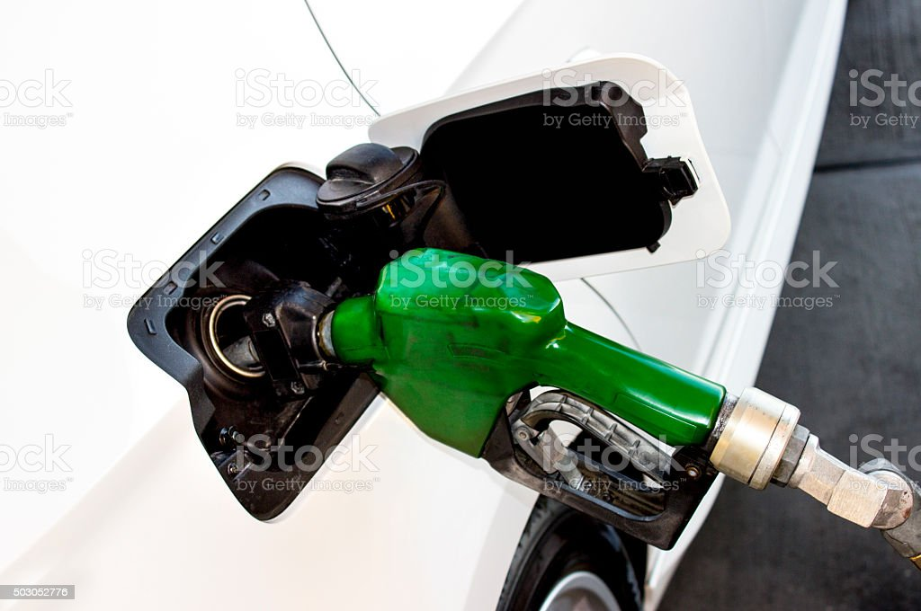 High angle view of gas pump attached gas tank stock photo
