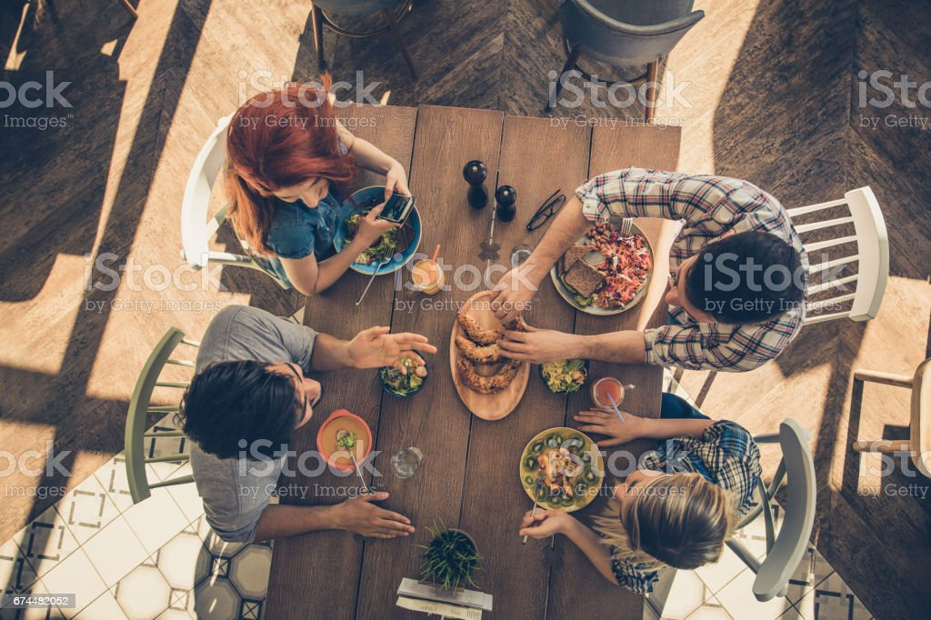 Above view of group of happy people relaxing in a cafe during their...