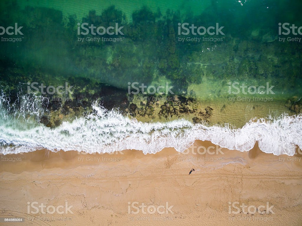 High angle view of man standing at the coastline stock photo