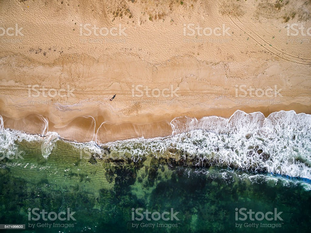 High angle view of man standing on the beach stock photo