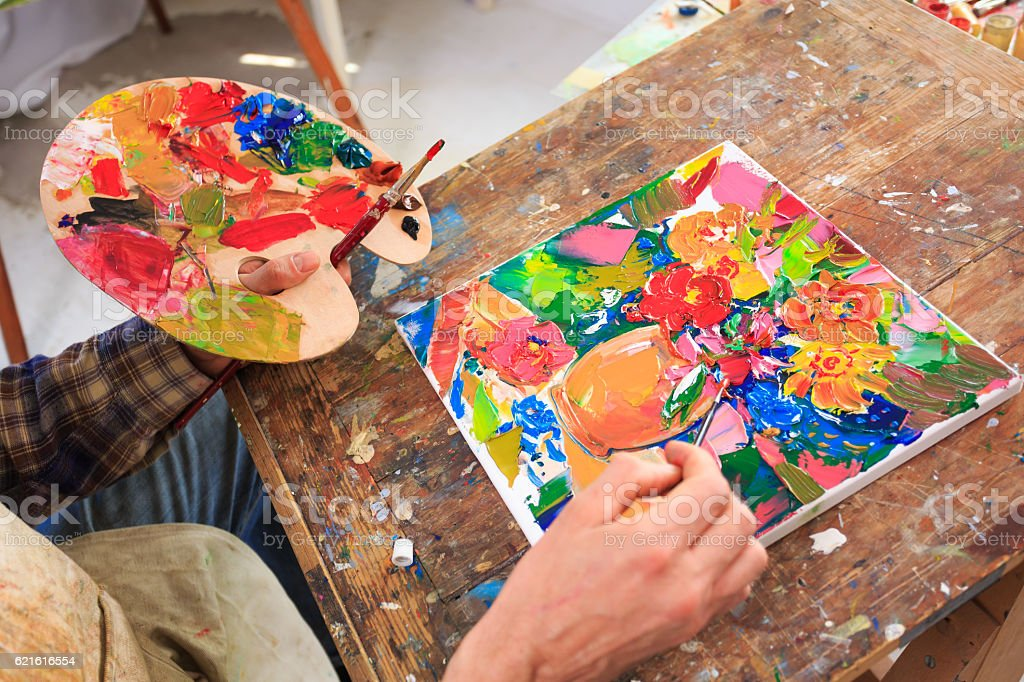 High angle view of man using a palette and brush stock photo