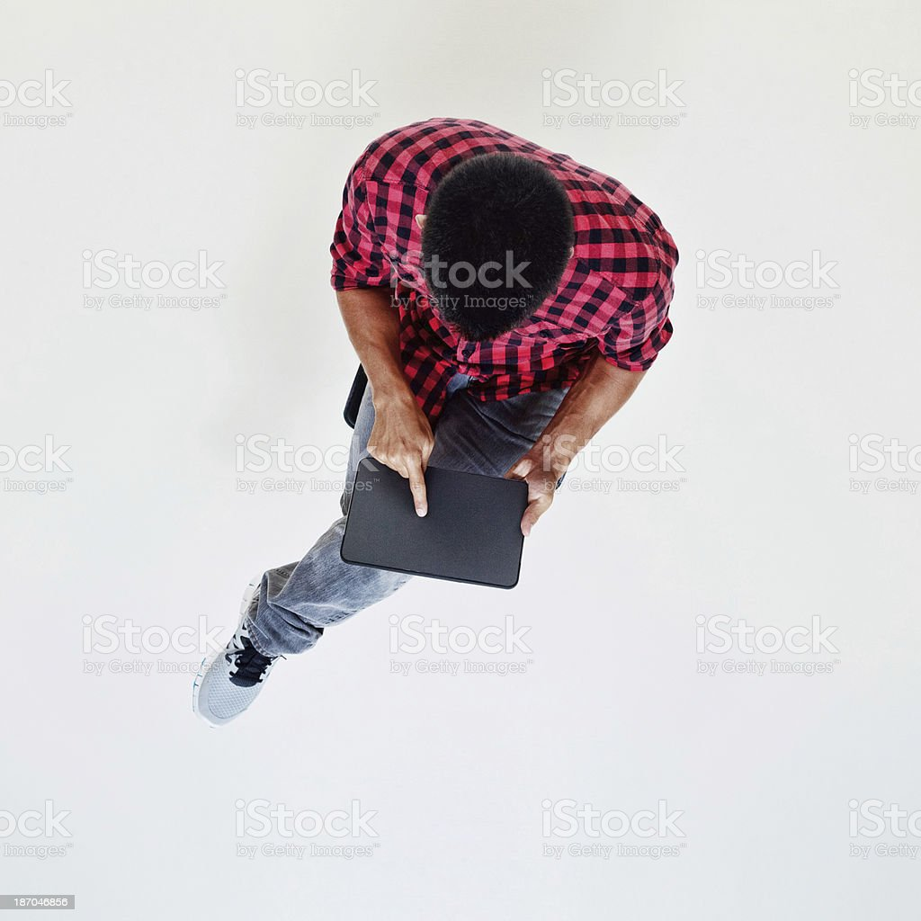 High angle view of man using tablet royalty-free stock photo