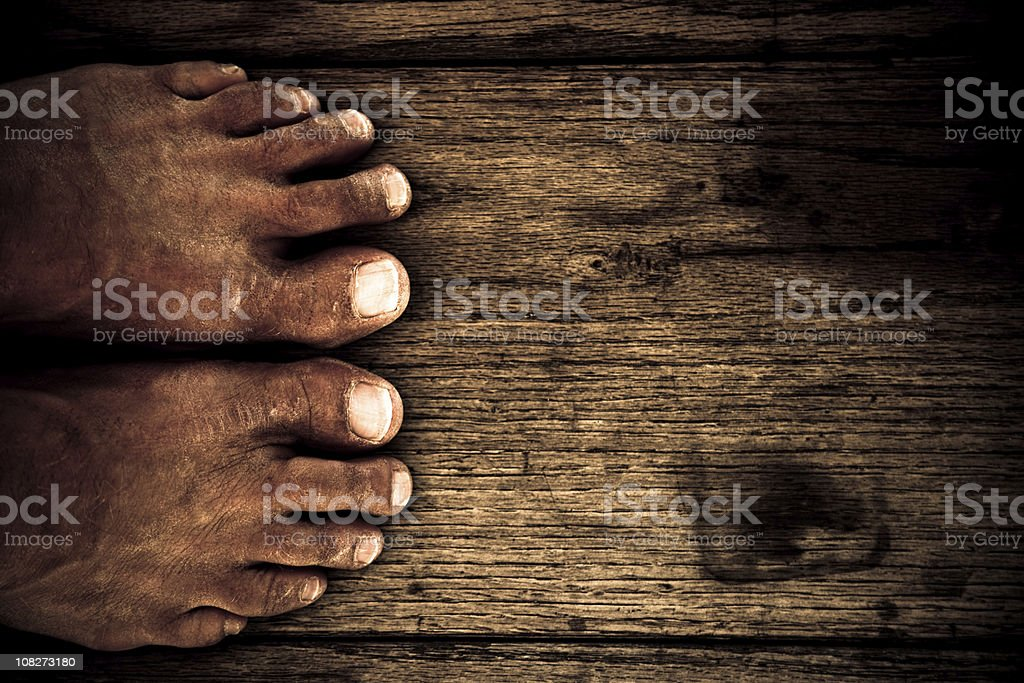 High Angle View of Man's Feet on Wooden Floor royalty-free stock photo