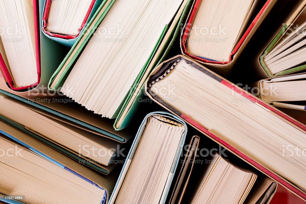 High angle view of many hardback books. Library or school. stock photo