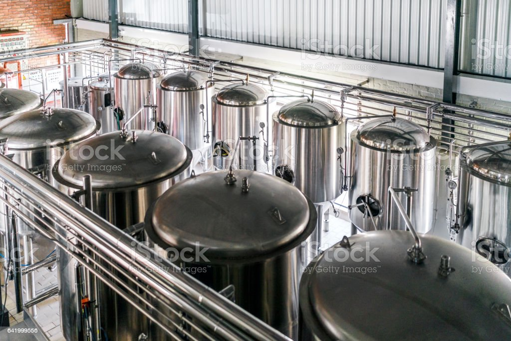 High angle view of metallic vats in brewery stock photo
