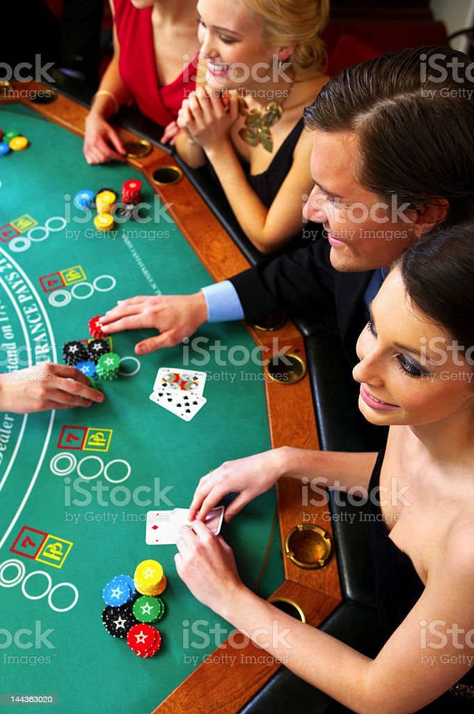 High angle view of people playing poker royalty-free stock photo