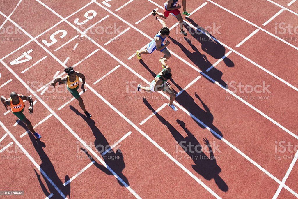 High angle view of people running in a sports track royalty-free stock photo