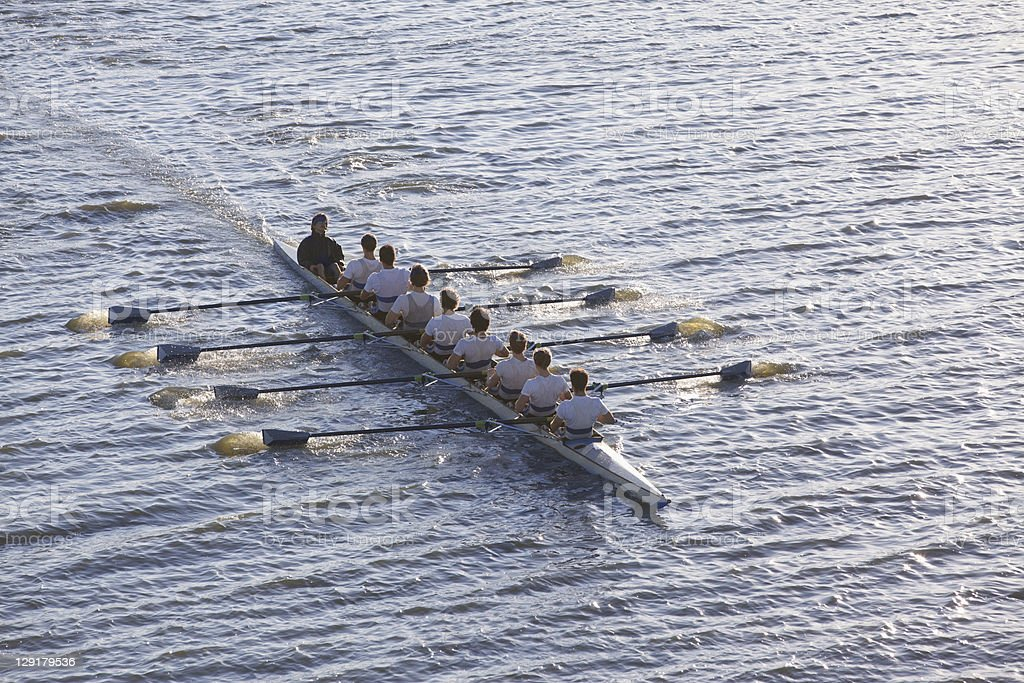 High angle view of people sitting in a row in a canoe stock photo