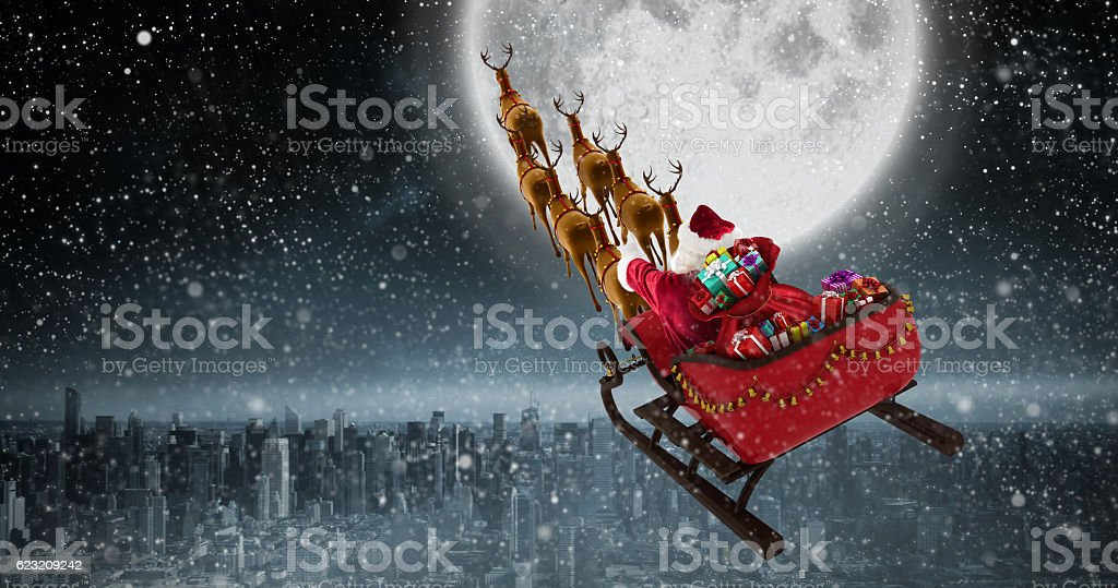 High angle view of Santa Claus riding on sled with stock photo