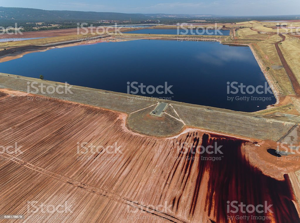 High Angle View of Tailing Pond and Surrounding Area stock photo