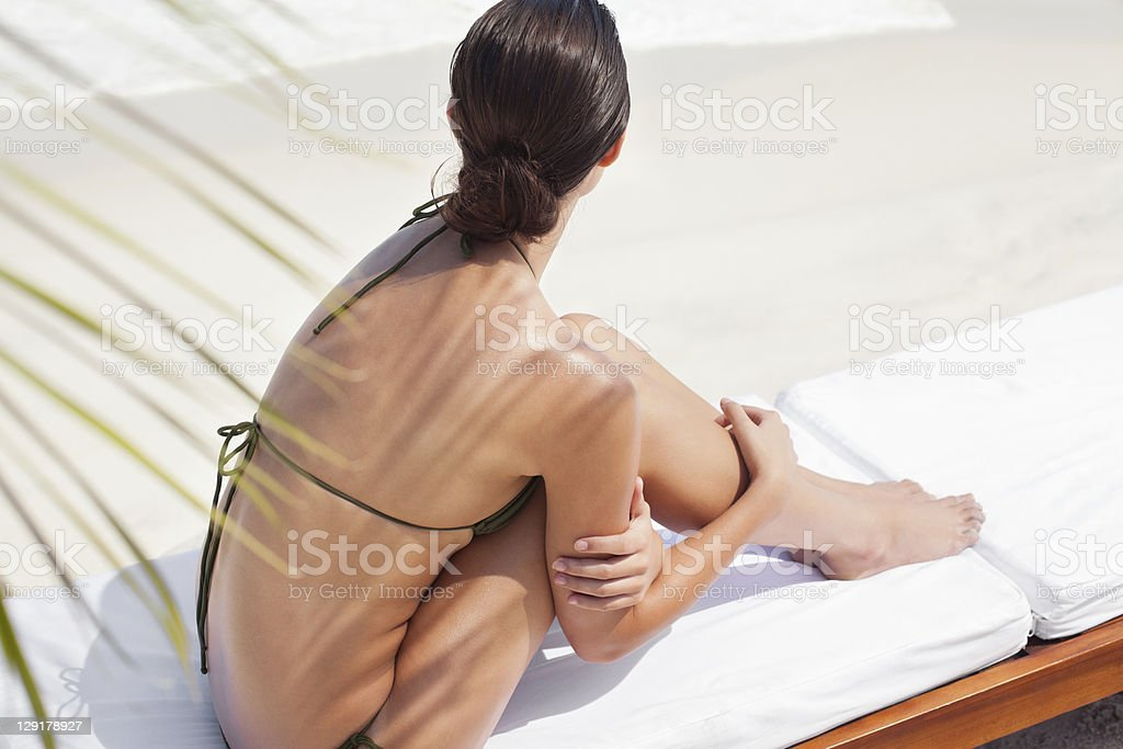 High angle view of teenage girl sitting at pool side royalty-free stock photo