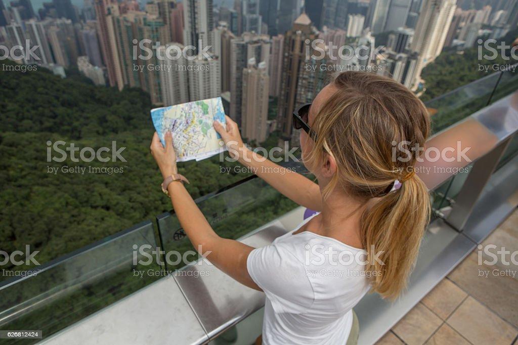 High angle view of tourist looking at map-Hong Kong stock photo