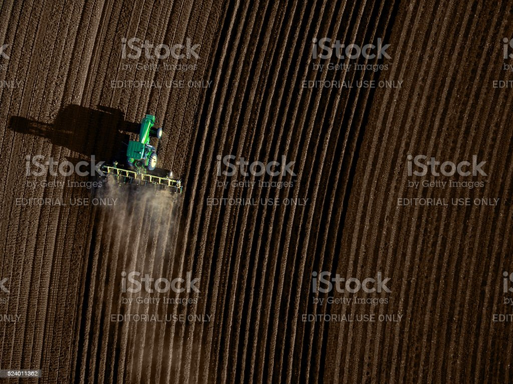High angle view of tractor plowing a field stock photo