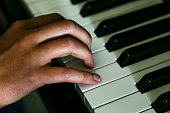 High angle view of unrecognizable person playing piano