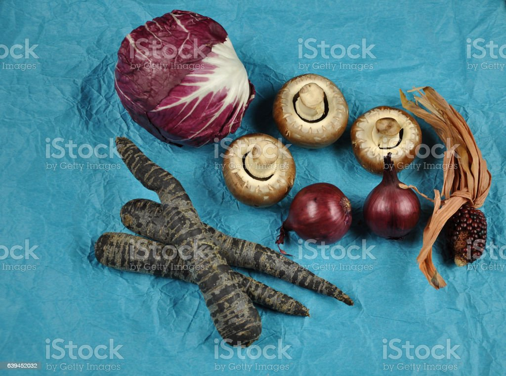 High angle view of various vegetables on blue background stock photo