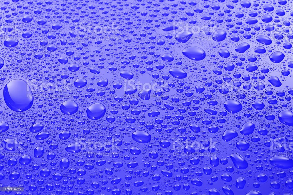 High angle view of water drops on blue surface royalty-free stock photo
