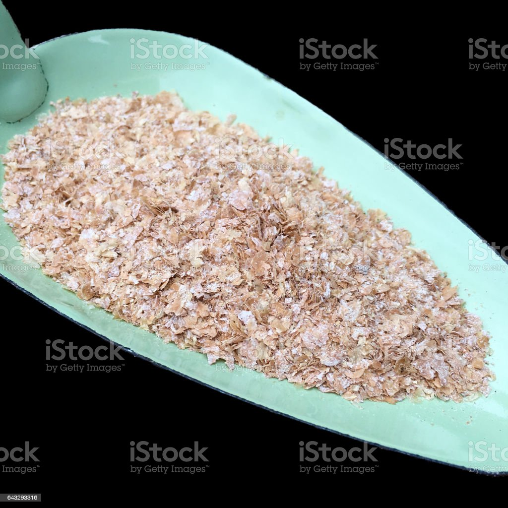 High angle view of wheat bran with on a green shovel stock photo