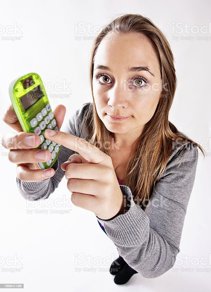 High angle view of woman holding lime green calculator royalty-free stock photo