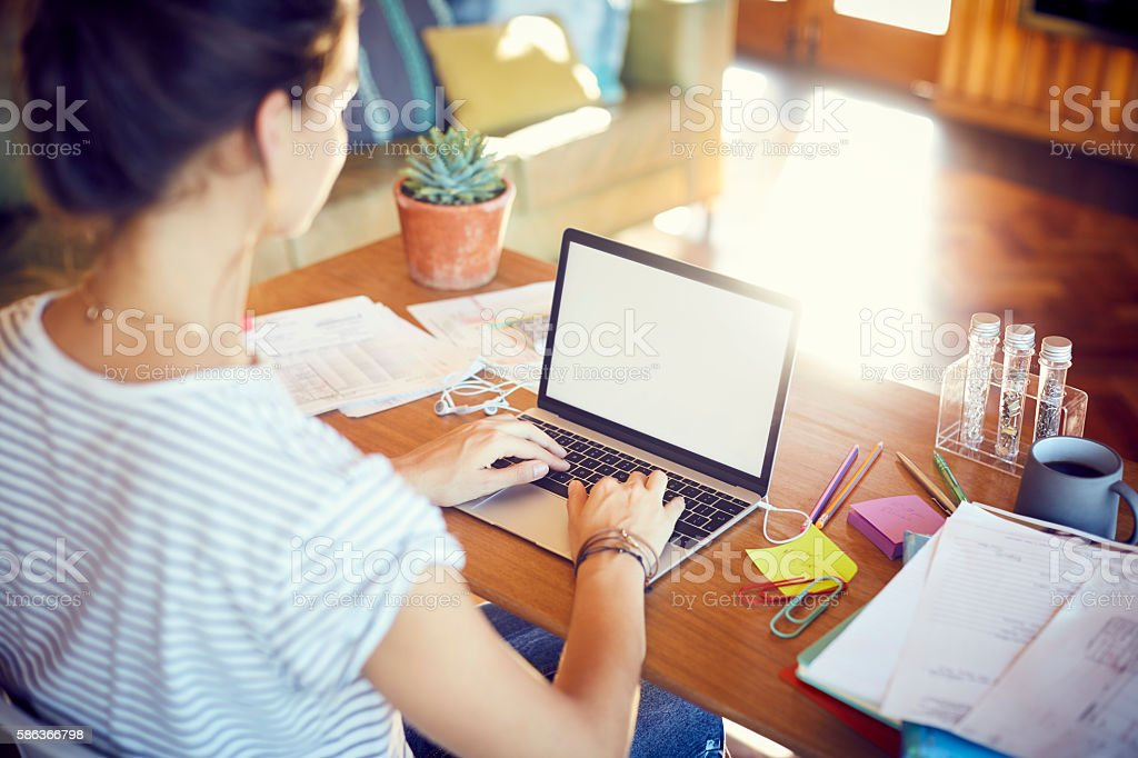 High angle view of woman is working at desk stock photo