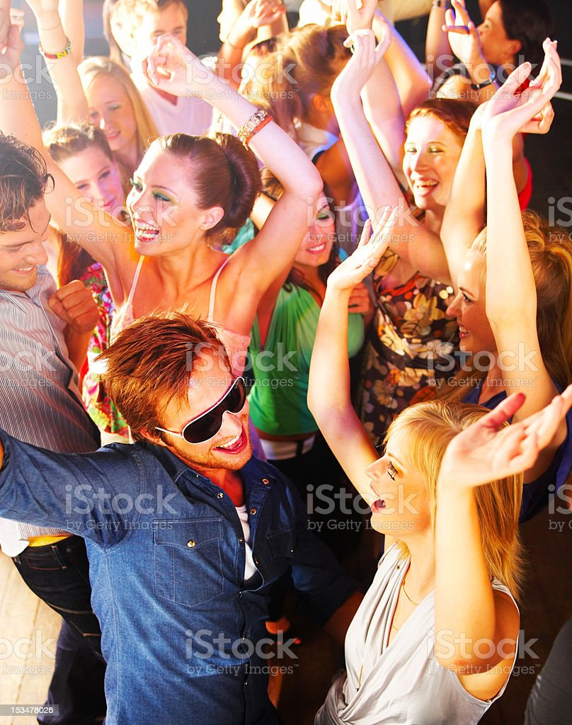 High angle view of young people dancing at a nightclub stock photo