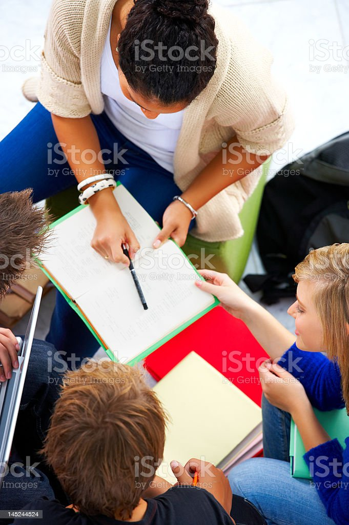 High angle view of young students studying together royalty-free stock photo