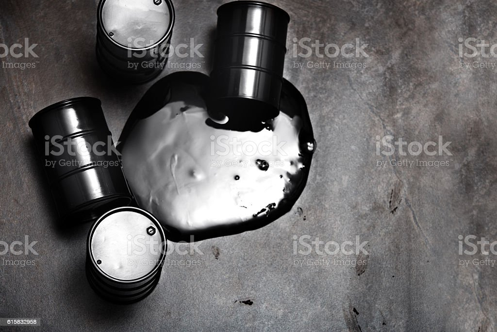 High angle view on four fuel barrels with spilled oil stock photo