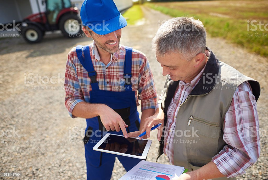 High angle view on modern farmers with digital tablet stock photo