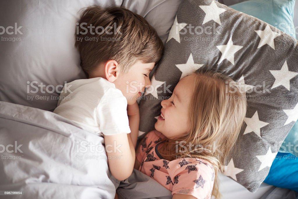 High angle view on sleeping siblings stock photo