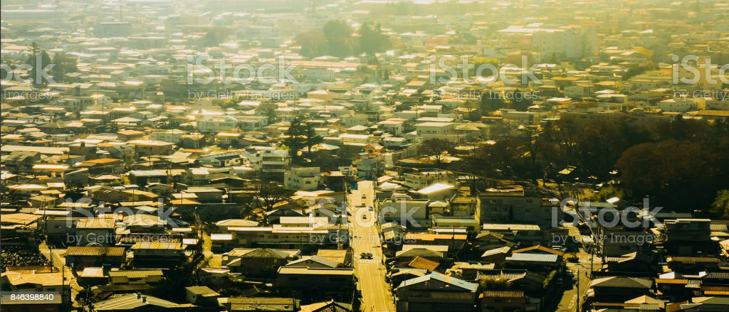 high angle view sunset with cityscape from country road in small town stock photo