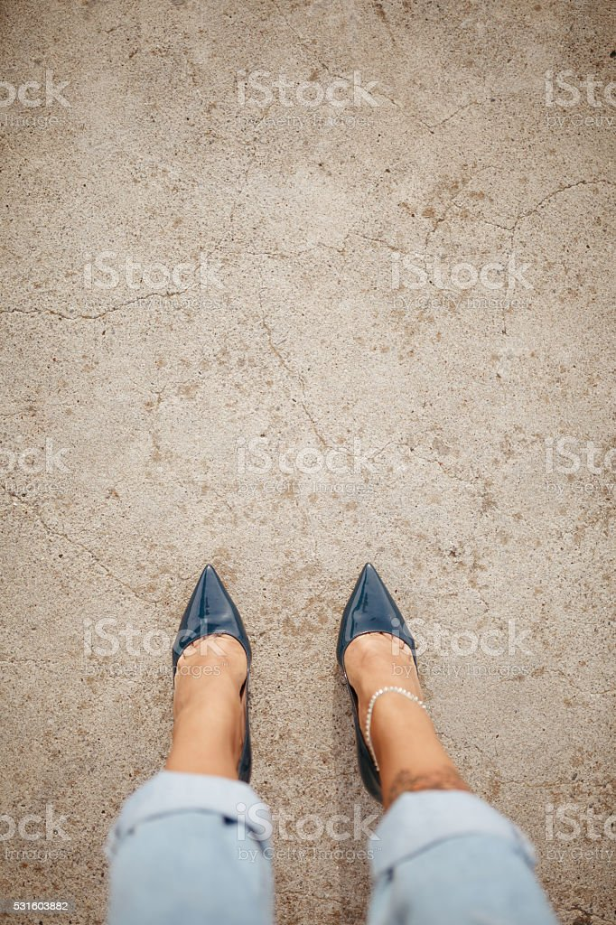 High angle view woman looking high heels shoes stock photo