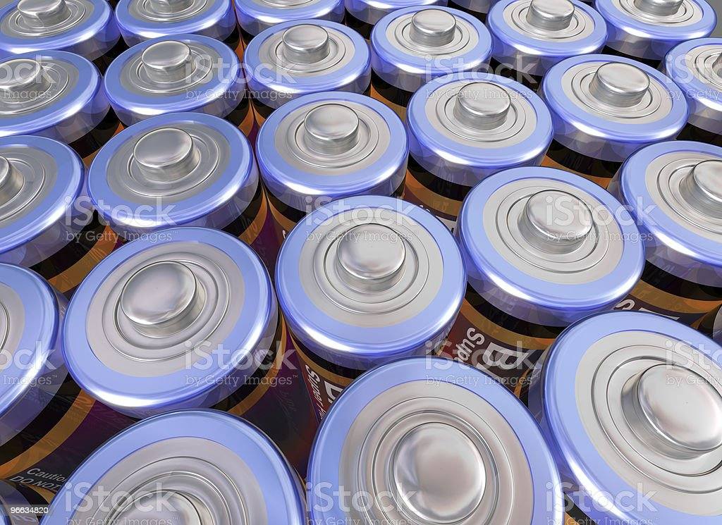High angled view of the top of many rows of batteries stock photo