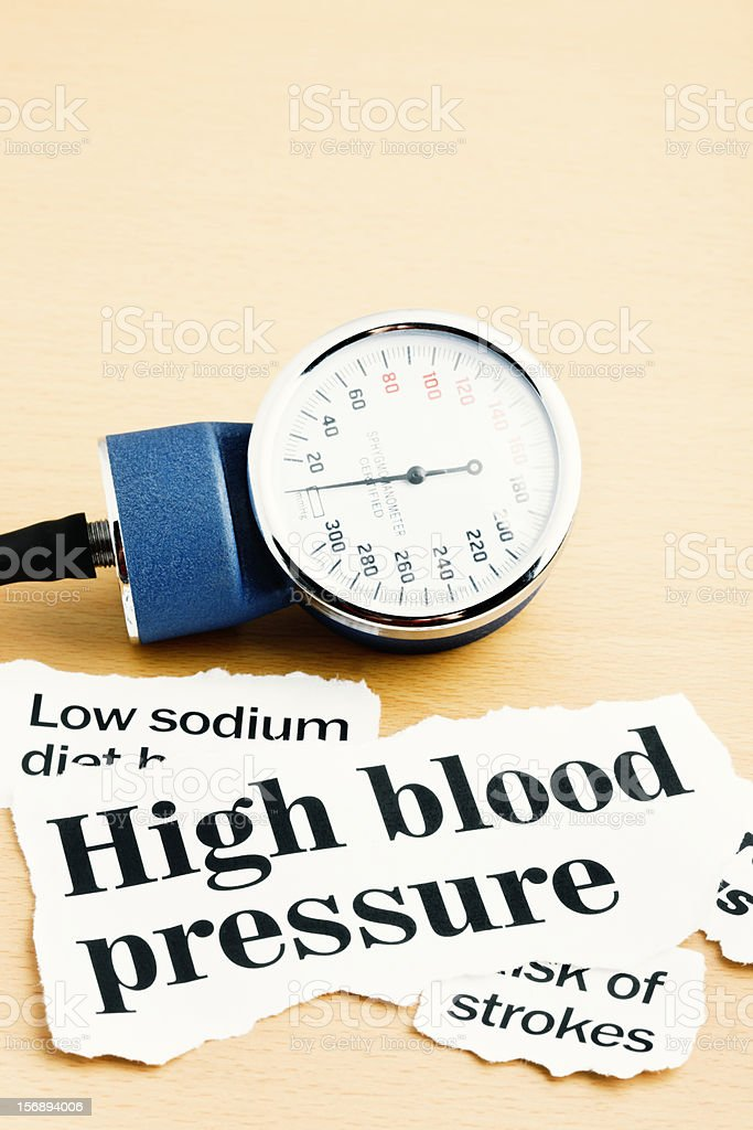 High blood pressure headlines with gauge for measuring it stock photo