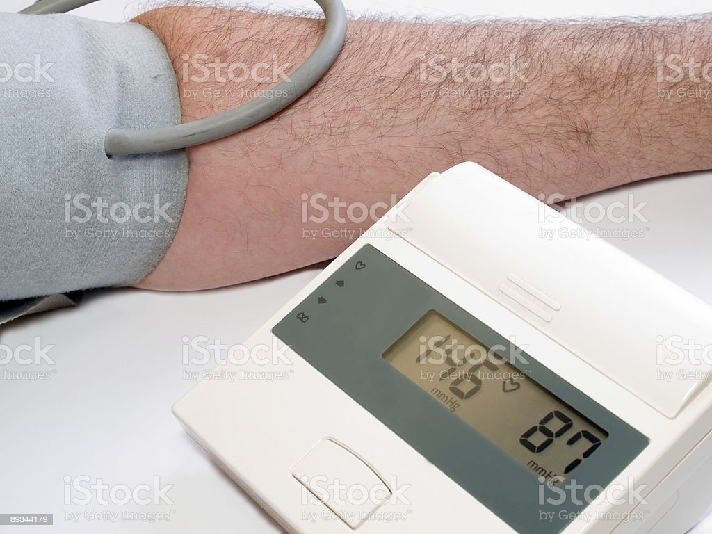 high blood pressure measuring with automatic tonometer stock photo