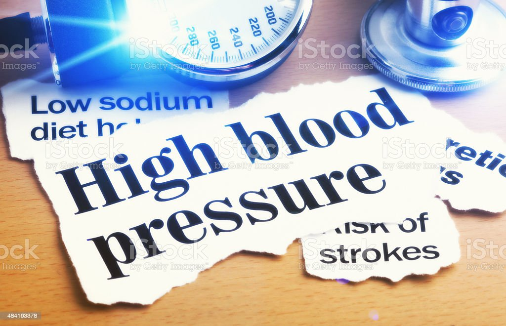 High blood-pressure headlines with stethoscope stock photo