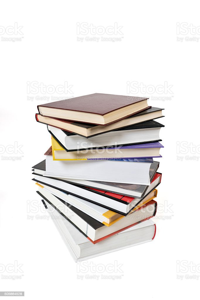 High books stack isolated, white background. Many colorful book covers. stock photo