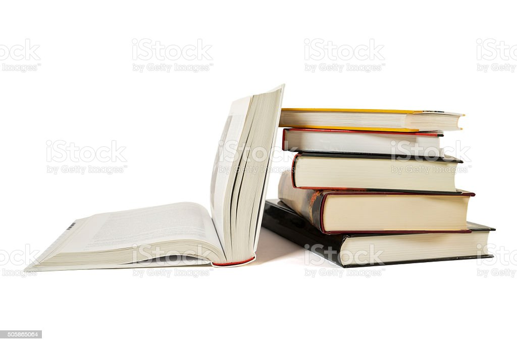 High books stack, open book isolated white background. Colorful covers. stock photo
