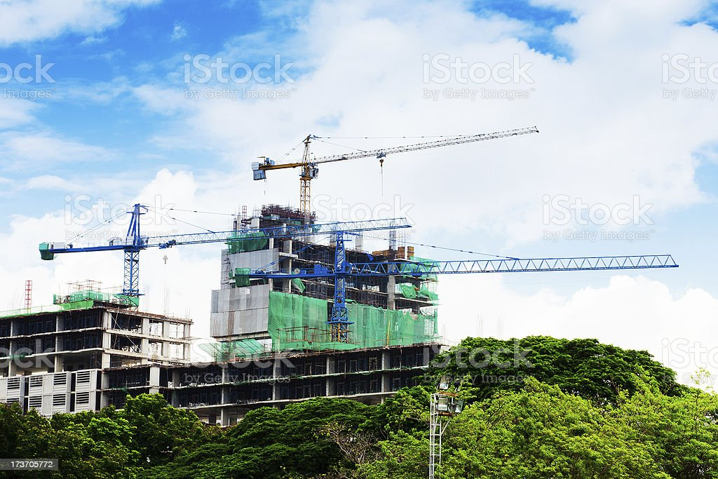 high buildings under construction with cranes at evening royalty-free stock photo