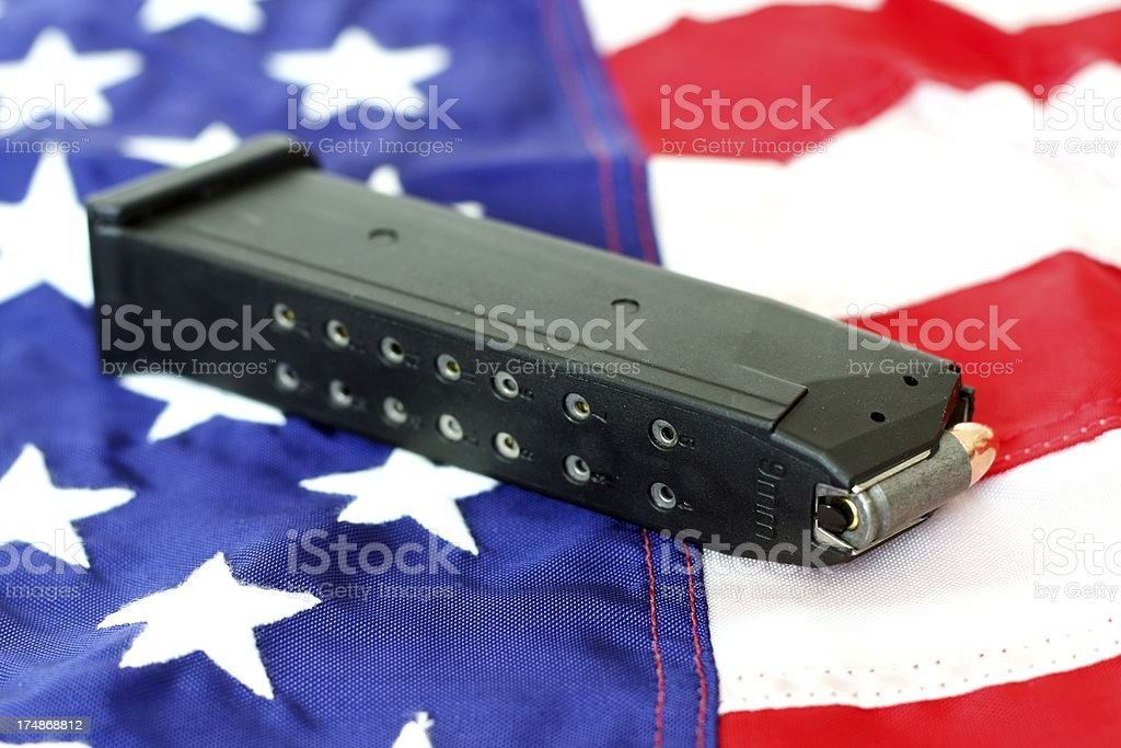 High Capacity Handgun Magazine on a US Flag stock photo