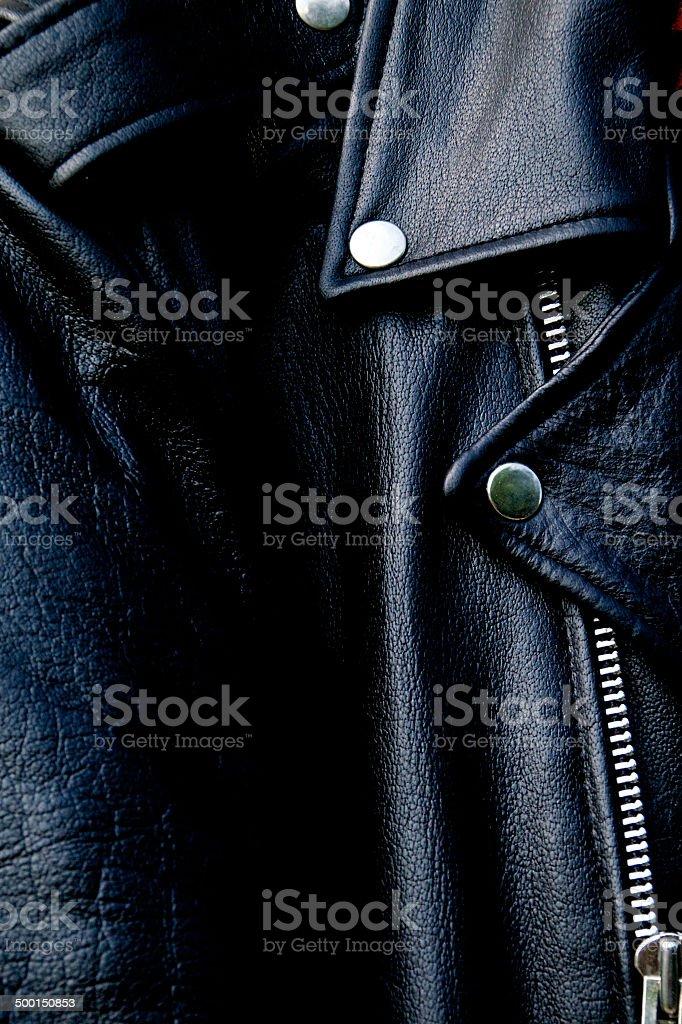 high contrast black leather biker jacket up close stock photo
