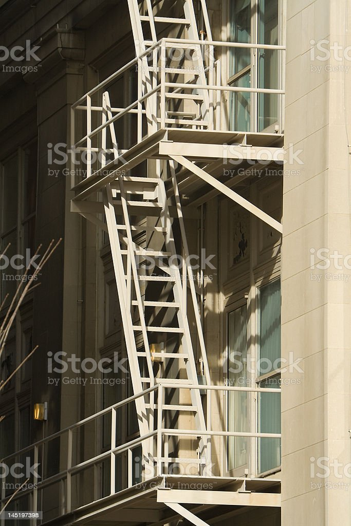 High Contrast Fire Escape on Old Building stock photo
