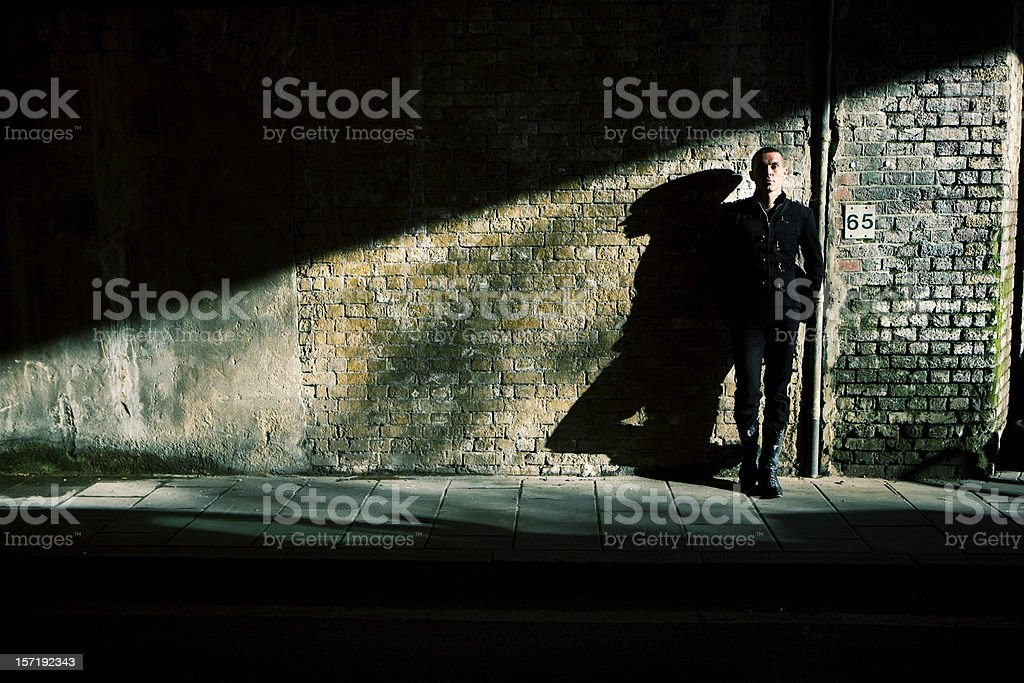 High contrast, full length portrait of a confident urban character stock photo