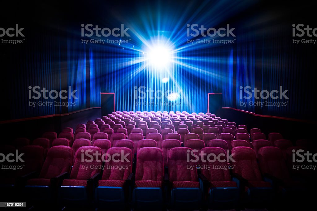 High contrast image of empty movie theater seats stock photo