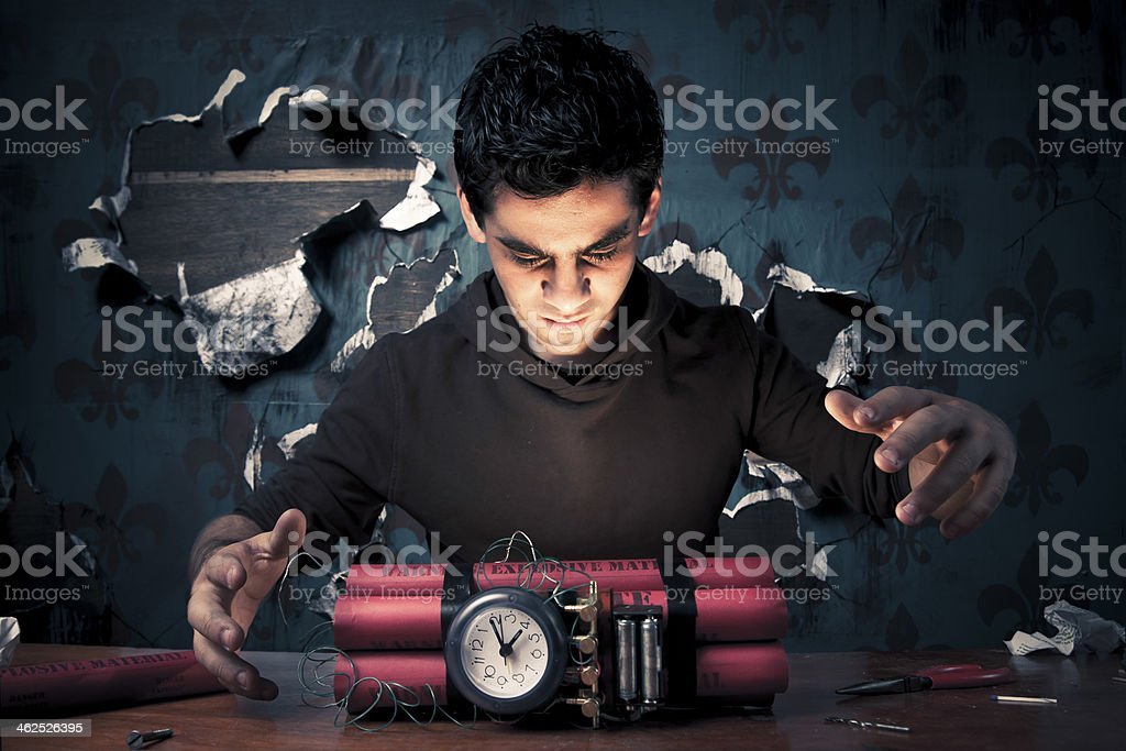high contrast image of terrorist making a timebomb royalty-free stock photo