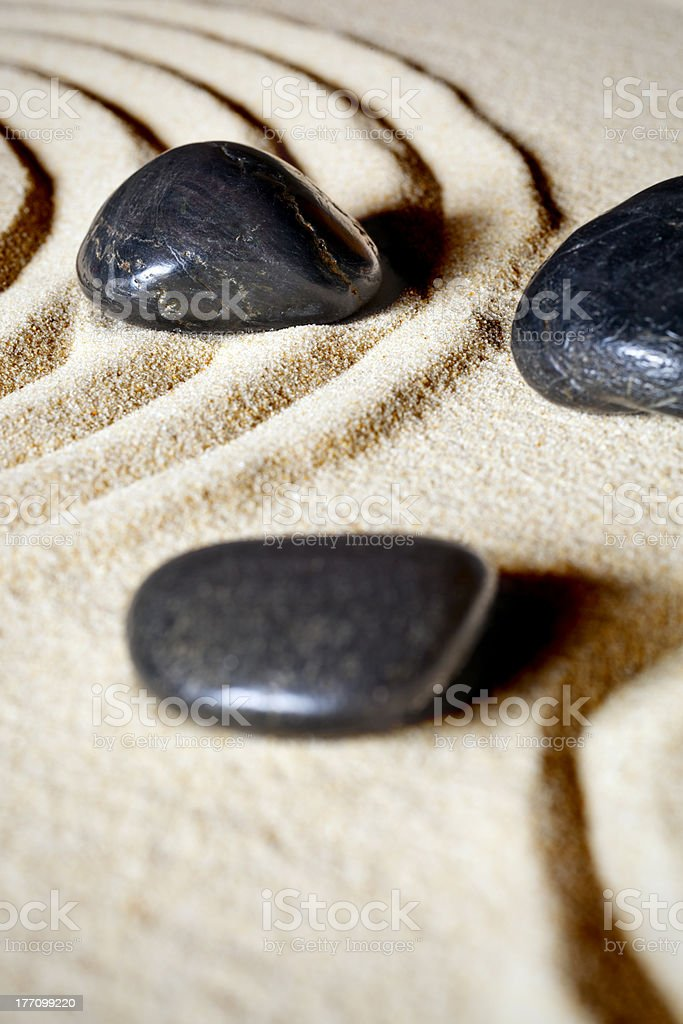 High Contrast  Massage Stones in Sand royalty-free stock photo