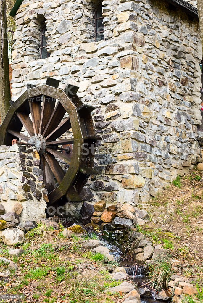 High contrast waterwheel on a stone mill stock photo