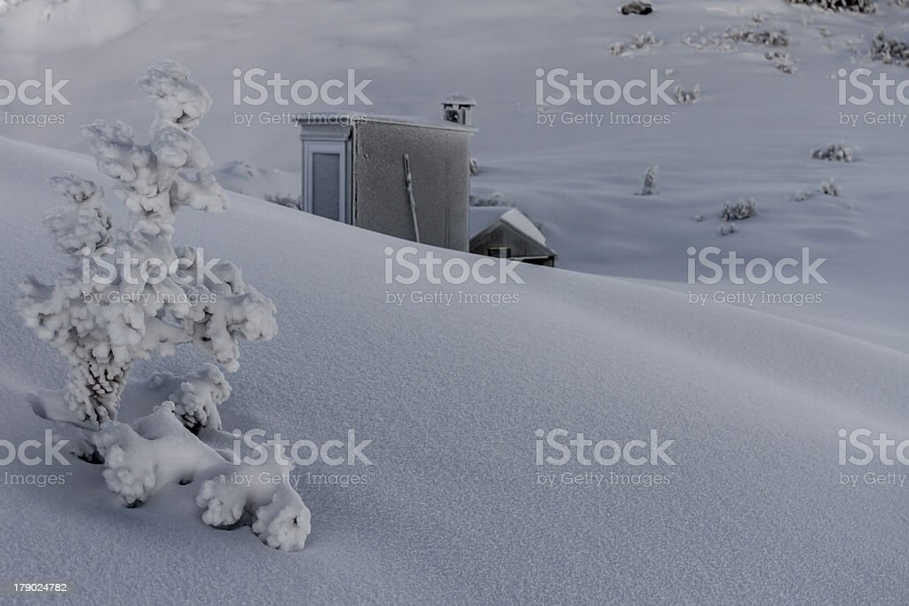 High country hut in deep snow royalty-free stock photo